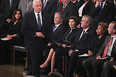 Vice President Mike Pence walks past former U.S. President George W. Bush, his wife former first lady Laura Bush and brother former Florida Governor Jeb Bush as Pence takes the podium to speak about the president's father former President George H.W. Bush during ceremonies in the U.S. Capitol Rotunda in Washington, U.S., December 3, 2018. REUTERS/Jonathan Ernst/Pool