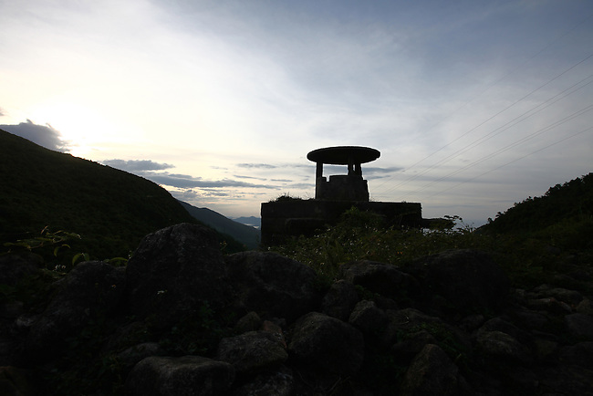 A concrete bunker overlooks the Hai Van Pass near Da Nang, Vietnam. French soldiers built the structure during their losing struggle against Viet Minh guerrillas from 1945 to 1954, and U.S. troops occupied it and others nearby during the Vietnam War a decade later. The bunkers are scarred with numerous bullet holes, an enduring testimony to the frequent combat that once took place here. Aug. 12, 2012.