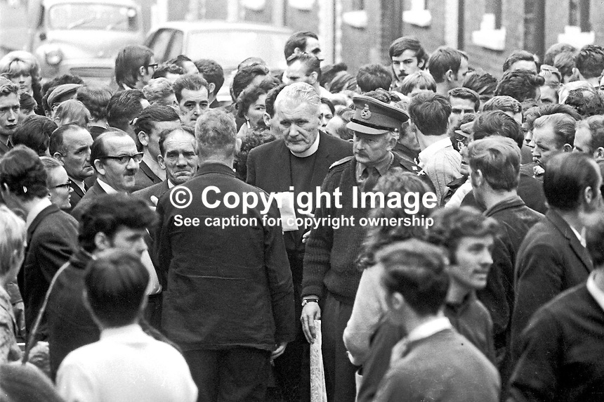 Father Padraig Murphy, St Peter's Roman Catholic Church, Falls Road, Belfast, N Ireland, UK, accompanied by Major General Tony Dyball, the British Army military commander in Belfast, tour the Falls Road area appealing for the removal of barricades. 196909160252a.<br /> <br /> Copyright Image from Victor Patterson,<br /> 54 Dorchester Park, Belfast, UK, BT9 6RJ<br /> <br /> t1: +44 28 90661296<br /> t2: +44 28 90022446<br /> m: +44 7802 353836<br /> <br /> e1: victorpatterson@me.com<br /> e2: victorpatterson@gmail.com<br /> <br /> For my Terms and Conditions of Use go to<br /> www.victorpatterson.com