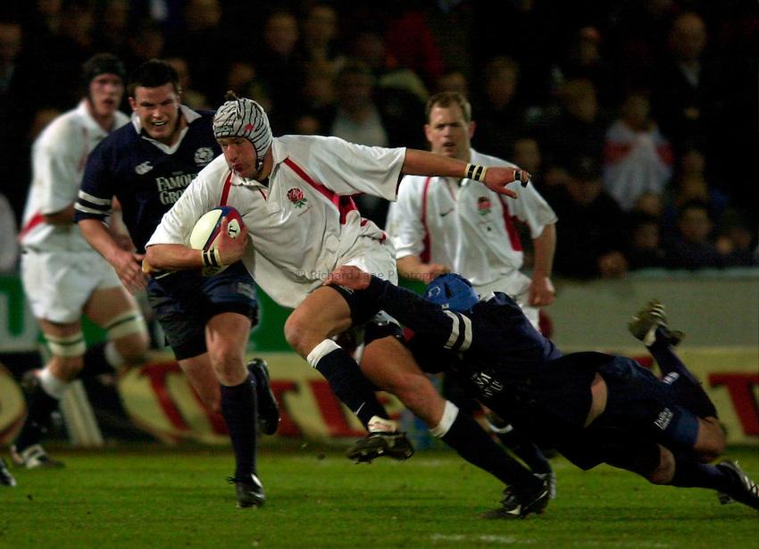 Photo. Richard Lane.England A v Scotland A at Franklins Gardens, Northampton. 20/03/2003.James Forrester is tackled.