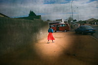 JOHANNESBURG, SOUTH AFRICA - JULY 13: A woman walks along the street in Soweto on July 13, 2006, in Johannesburg, South Africa. (Photo by Landon Nordeman).
