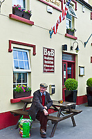 Elderly Irish man has a beer and a rest after shopping at farmers' market, Ballyvaughan, County Clare, West of Ireland