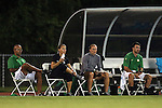 04 September 2015: Oregon head coach Kat Mertz (second from left) with assistant coaches Manny Martins (left), Christie Welsh, and Tom Serratore (right). The North Carolina State University Wolfpack hosted the Oregon University Ducks at Dail Soccer Field in Raleigh, NC in a 2015 NCAA Division I Women's Soccer game. NC State won the game 2-0.
