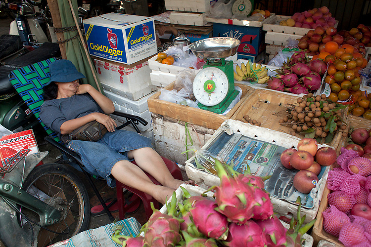 Sleeping vegetable vendor Phnom Penh, Cambodia. <br /> <br /> Photos &copy; Dennis Drenner 2013.
