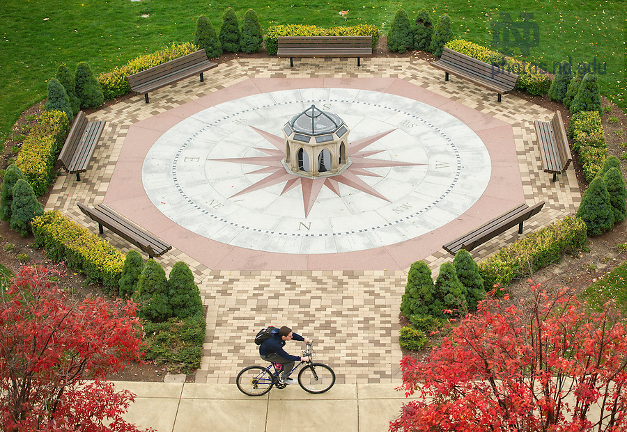 Oct. 28, 2014; A student rides past the main entrance of Jordan Hall of Science. (Photo by Barbara Johnston/University of Notre Dame)