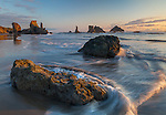 Bandon State Park, Oregon<br /> Evening light on waves and tidal rocks with distant seastacks at Bandon Beach