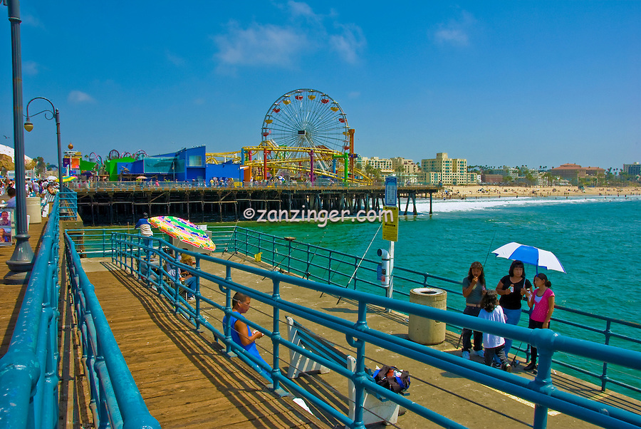 Pacific Park, Santa Monica, CA, Pier, Boardwalk, Ferris Wheel, Roller Coaster, Amusements, Holiday, Walking, playing, Tourist, Beach, water, sand, California, USA,