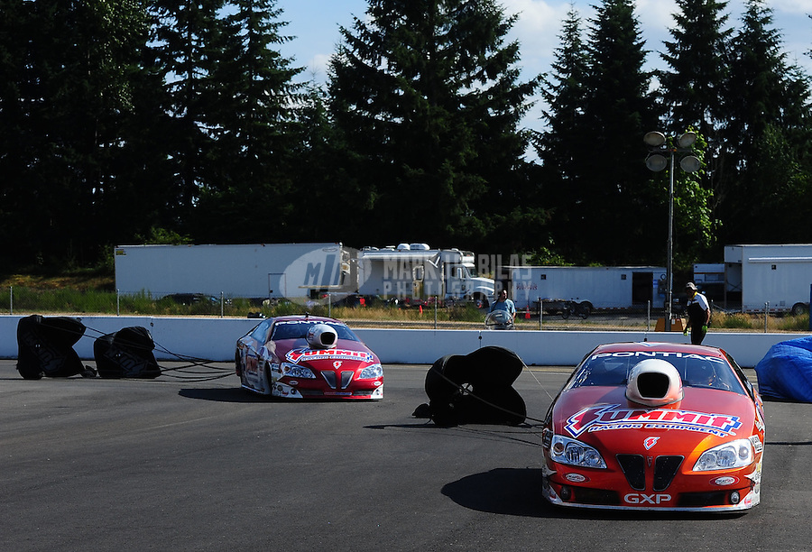 Aug. 7, 2011; Kent, WA, USA; NHRA pro stock driver Jason Line (right) after defeating teammate Greg Anderson during the Northwest Nationals at Pacific Raceways. Mandatory Credit: Mark J. Rebilas-