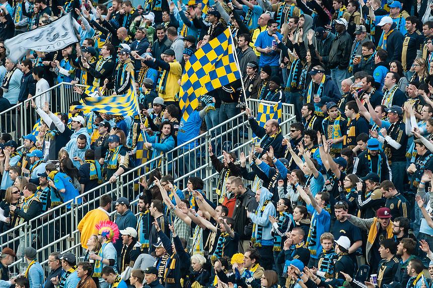MLS soccer fans cheer a goal.
