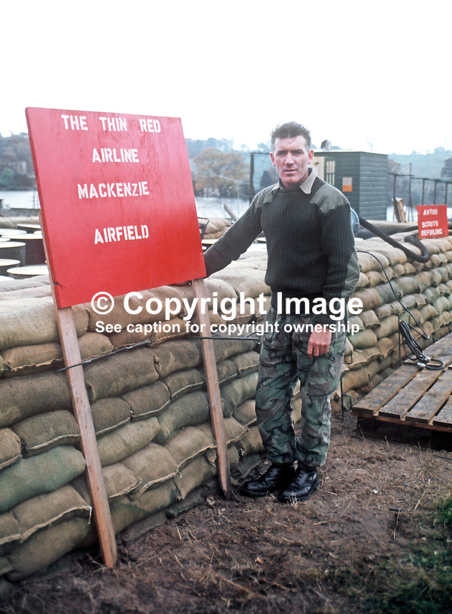 Soldier from Argyll &amp; Sutherland Highlanders, based in South Armagh, N Ireland, a Provisional IRA stronghold, with ad hoc signage for their local airport! November, 1972, 197211000772b<br /><br />Copyright Image from Victor Patterson, 54 Dorchester Park, Belfast, UK, BT9 6RJ<br /><br />t1: +44 28 9066 1296 (from Rep of Ireland 048 9066 1296)<br />t2: +44 28 9002 2446 (from Rep of Ireland 048 9002 2446)<br />m: +44 7802 353836<br /><br />e1: victorpatterson@me.com<br />e2: victorpatterson@gmail.com<br /><br />The use of my copyright images is subject to my Terms &amp; Conditions.<br /><br />It is IMPORTANT that you familiarise yourself with them. They are available on my website at www.victorpatterson.com.<br /><br />None of my copyright images may be used on a website unless they are visibly watermarked, i.e. &copy; Victor Patterson within the body of the visible image. Metadata denoting my copyright must NOT be deleted. <br /><br />Web use is extra at currently recommended NUJ rates.