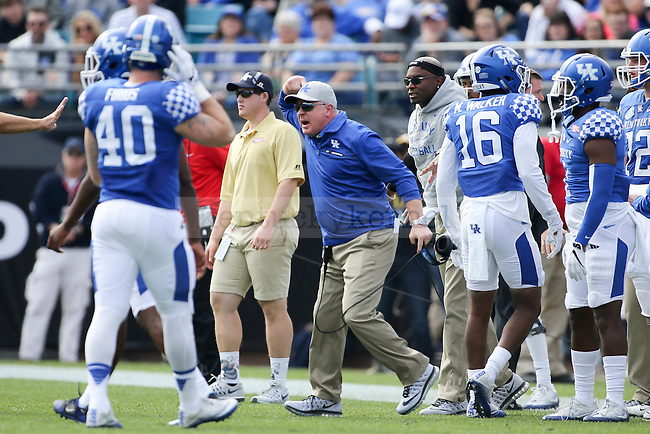 Head coach Mark Stoops of the Kentucky Wildcats reacts during the first half of the TaxSlayer Bowl against the Georgia Tech Yellow Jackets at EverBank Field on Saturday, December 31, 2016 in Jacksonville, Florida. Photo by Michael Reaves | Staff.