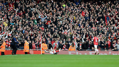 17.11.2012.  London, England. Lukas Podolski Of Arsenal celebrates scoring during the Premier League game between Arsenal and Tottenham Hotspur from the Emirates Stadium.