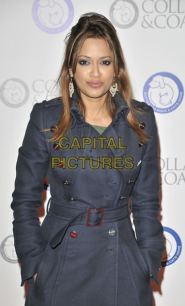 Tasmin Lucia-Khan.The Collars & Coats Gala Ball 2011, Battersea Evolution, Battersea Park, London, England..November 11th, 2011.half length navy blue mac jacket hands in pockets.CAP/CAN.©Can Nguyen/Capital Pictures.