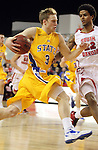 VERMILLION, SD - FEBRUARY 9: Nate Wolters #3 from South Dakota State drives against Allen Saint-Gelais #22 from the University of South Dakota in the first half of their game Thursday night at the DaktaDome in Vermillion, SD. (Photo by Dave Eggen/Inertia)