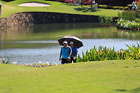 Prom Meesawat (THA) and Greame McDowell (NIR) walk up the 6th fairway during Round 3 of the Maybank Malaysian Open at the Kuala Lumpur Golf & Country Club on Saturday 7th February 2015.<br /> Picture:  Thos Caffrey / www.golffile.ie