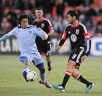 Sporting Kansas City midfielder Roger Espinoza (15) goes against D.C. United midfielder Dejan Jakovic (5) Sporting Kansas City defeated D.C. United  1-0 at RFK Stadium, Saturday March 10, 2012.