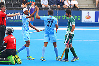 Akashdeep Singh congratulates Mandeep Singh on scoring for India during the Hockey World League Semi-Final 5-8th place match between Pakistan and India at the Olympic Park, London, England on 24 June 2017. Photo by Steve McCarthy.