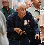 Korean War veteran Bill Juergens of Shiloh, who served in the Air Force, stands during the pledge of allegiance. The city of Belleville held their 21st annual Veterans Day ceremony inside Belleville City Hall on Thursday November 11, 2019. It was moved inside due to the winter weather.<br /> Photo by Tim Vizer
