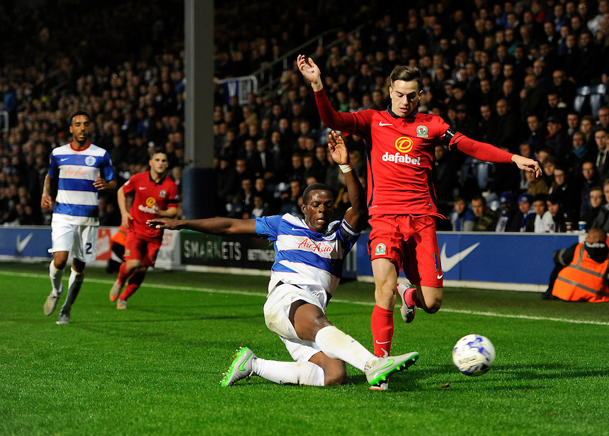 Blackburn Rovers' Tom Lawrence is tackled by Queens Park Rangers' Nedum Onuoha<br /> <br /> Photographer Ashley Western/CameraSport<br /> <br /> Football - The Football League Sky Bet Championship - Queens Park Rangers v Blackburn Rovers - Wednesday 16th September 2015 - Loftus Road - London <br /> <br /> &copy; CameraSport - 43 Linden Ave. Countesthorpe. Leicester. England. LE8 5PG - Tel: +44 (0) 116 277 4147 - admin@camerasport.com - www.camerasport.com