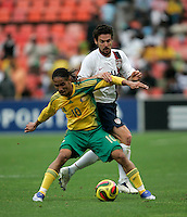 USA's Heath Pearce and South Africa's Steven Pienaar during first half action between the national teams of South Africa (RSA) and the United States (USA) in an international friendly dubbed the Nelson Mandela Challenge at Ellis Park Stadium in Johannesburg, South Africa on November 17, 2007.
