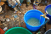 A water-well which is located less than a hundred yards from the nearby open dump site. Well-water like this is found in many neighborhoods of Kano and is used by residents for washing dishes, clothes and bathing.