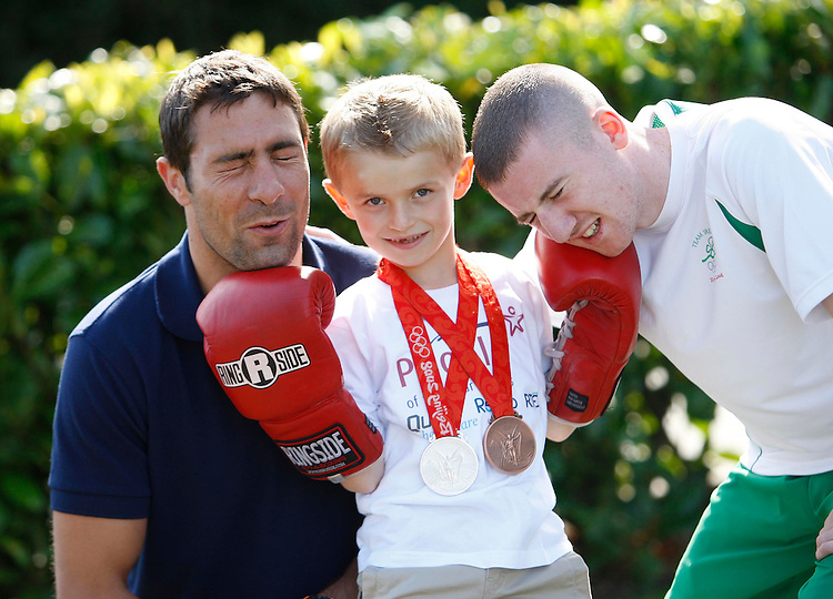 Ronan Hayes, age 7 from Co. Cork a recipient of this years People the Year awards, (centre) with Olympic Boxing heros, Kenny Egan (left) and Paddy Barnes who also received awards pictured here prior to the 34th annual People of the year awards, organised by Rehab and sponsored by Quinn-healthcare held in Citywest Hotel, Dublin. pic. Robbie Reynolds.