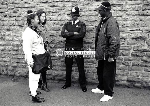 Teenagers with policeman Nottingham, UK 1990s