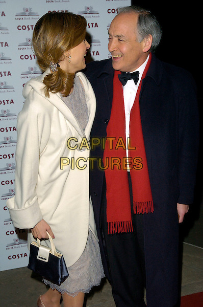 KATIE DERHAM & ALASTAIR STEWART.The Costa Book Of The Year Award 2006, Grosvenor House Hotel, Park Lane, London, UK..February 7th, 2007.half length white cream coat wide collar blue coat red scarf  bag purse profile hair ponytail.CAP/CAN.©Can Nguyen/Capital Pictures