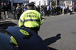 (Medford Ma 042113) A Medford police officer looks at the long line of mourners lined up side street in Medford for the wake for Boston Marathon victim Krystle Campbell, Sunday in Medford.   (Jim Michaud Photo)