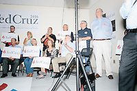 People listen as Texas senator and Republican presidential candidate Ted Cruz speaks to a crowd at the kick-off event at his New Hampshire campaign headquarters in Manchester, New Hampshire.