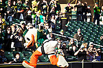 010213--The Oregon Duck trips over a rope before greeting fans after landing at Salt River Fields in a parachute during the Ducks pep rally in  Scottsdale, Arizona. .Photo by Jaime Valdez