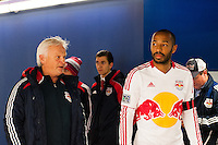 New York Red Bulls Hans Backe talks with Thierry Henry (14) during a snow delay prior to playing D. C. United during the second leg of the MLS Eastern Conference Semifinals at Red Bull Arena in Harrison, NJ, on November 7, 2012.