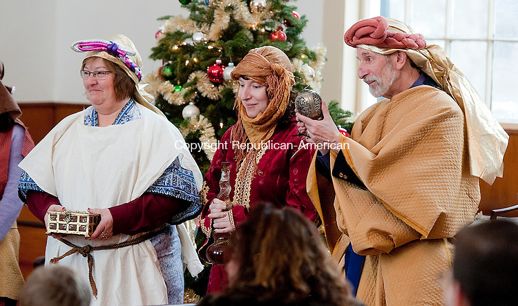 BARKHAMSTED,  CT-122114JS06- The Three Kings, portrayed by Dandy Davis, Averill Blackburn and Steven Blackburn, prepare to pre send gifts to the baby Jesus during the17th annual Christmas Pageant held Sunday at the First Congregational Church of Barkhamsted. <br /> Jim Shannon Republican-American