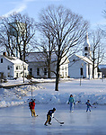 Belchertown residents Ryan P. Foley, 10, left, Aaron Rivest, 12, Kelley M. Foley, Ryan's mother, and Meaghan E. Foley, 5, skate on a flooded portion of the Belchertown Town Common on Friday, January 24, 2003. Photo by Christopher Evans