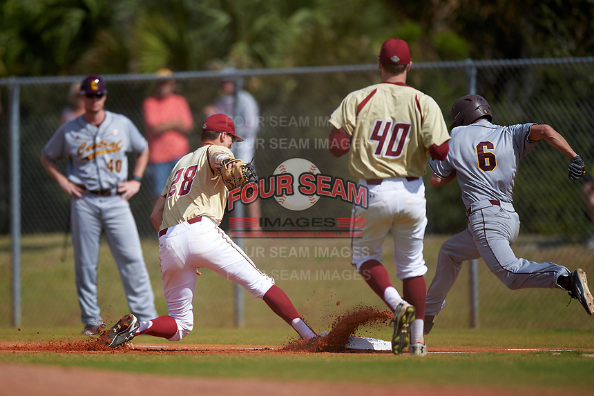 Boston College Eagles first baseman Mitch Bigras (28) beats base runner Alex Borglin (6) to the bag as pitcher Zach Stromberg (40) backs up the play during a game against the Central Michigan Chippewas on March 8, 2016 at North Charlotte Regional Park in Port Charlotte, Florida.  Boston College defeated Central Michigan 9-3.  (Mike Janes/Four Seam Images)