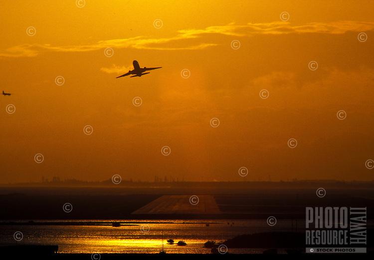 Airplane taking off at sunset, Honolulu International airport, Oahu
