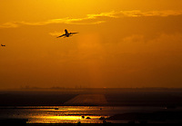 Airplane taking off at sunset, Honolulu International airport, Oahu
