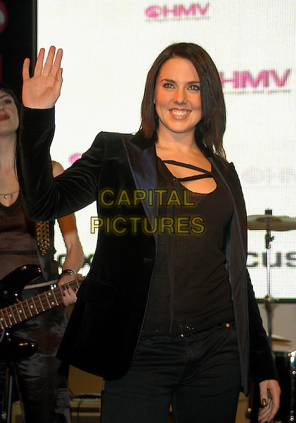 "MELANIE CHISHOLM - MEL C.at HMV music store to promote her new single ""Here It Come's again"".www.capitalpictures.com.sales@capitalpictures.com.© Capital Pictures.waving"