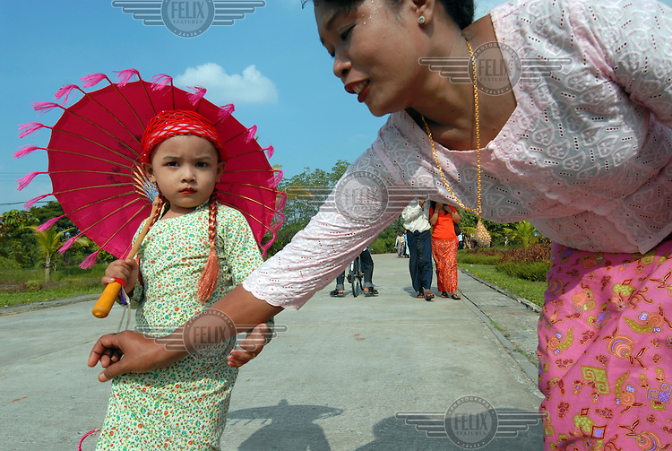A young girl dressed up at a 'Villages of the Union of Myanmar' theme park. The ruling junta are anxious to emphasise the traditional, folkloric and agrarian nature of the 'national races', and are deeply suspicious of 'outside' (or Western) influences that they see as undermining the stability of the union...
