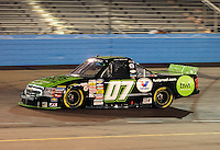 Nov. 13, 2009; Avondale, AZ, USA; NASCAR Camping World Truck Series driver Chad McCumbee during the Lucas Oil 150 at Phoenix International Raceway. Mandatory Credit: Mark J. Rebilas-