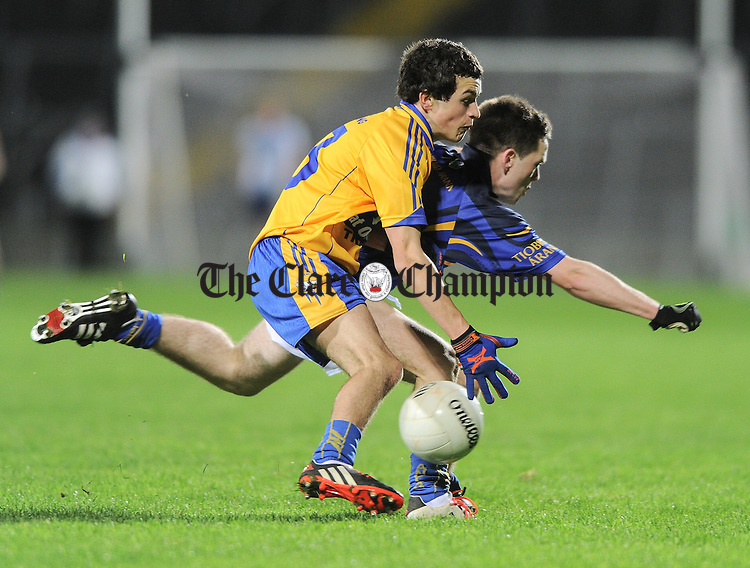 Michael Corry of Clare in action against Tommy Lowry of Tipperary during their U-17 Munster League final in The Gaelic Grounds. Photograph by John Kelly.