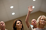 Republican presidential candidate Rep. Michele Bachmann worships at Living Word Outreach Ministries in Spencer, Iowa, July 31, 2011 while campaigning througout the state in advance of the Straw Poll.