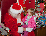 TORRINGTON,  CT-122016JS15--Santa talks with 18-month-old Maddie Mastriano of Torrington during her visit to Christmas Village in Torrington on Tuesday. While everyone was welcome that day, Santa who also knows sign language, was there to sign for all deaf or hearing-impaired visitors to Christmas Village. <br />  Jim Shannon Republican American