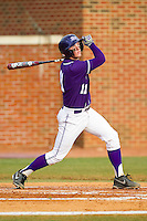 Spencer Angelis (11) of the High Point Panthers follows through on his swing against the Charlotte 49ers at Willard Stadium on February 20, 2013 in High Point, North Carolina.  The 49ers defeated the Panthers 12-3.  (Brian Westerholt/Four Seam Images)