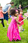 Old Westbury, New York, USA. 28th June 2015. NYLAH JEANTY, 2 1/2 years old, of Franklin Square, is wearing a long pink dress and dancing around the Maypole, as Lori Belilove & The Isadora Duncan Dance Company give dancing lessons to children throughout the gardens, and then perform at historic Old Westbury Gardens, a Long Island Gold Coast estate, for its Midsummer Night event.