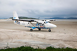 Flybe plane on sandy airstrip Isle of Barra airport , Barra, Outer Hebrides, Scotland, UK
