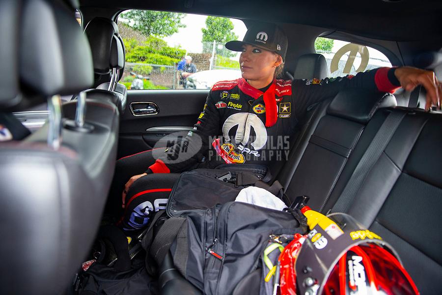 May 20, 2018; Topeka, KS, USA; NHRA top fuel driver Leah Pritchett waits in her teams tow vehicle during a delay to the Heartland Nationals at Heartland Motorsports Park. Mandatory Credit: Mark J. Rebilas-USA TODAY Sports