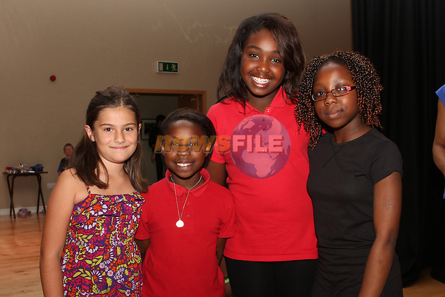 Lorea Alonso, Peace Chukwurah, Celine Chukwurah and Esther Aobieke at the Summer camp in the Barbican Theatre...(Photo credit should read Jenny Matthews/NEWSFILE)...