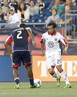 D.C. United forward Carlos Ruiz (20) takes on New England Revolution defender Andrew Farrell (2). In a Major League Soccer (MLS) match, the New England Revolution (blue) tied D.C. United (white), 0-0, at Gillette Stadium on June 8, 2013.