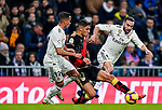 Santiago Comesana, Santi Comesana, of Rayo Vallecano (C) is tackled by Daniel Carvajal Ramos (R) and Lucas Vazquez of Real Madrid  during the La Liga 2018-19 match between Real Madrid and Rayo Vallencano at Estadio Santiago Bernabeu on December 15 2018 in Madrid, Spain. Photo by Diego Souto / Power Sport Images
